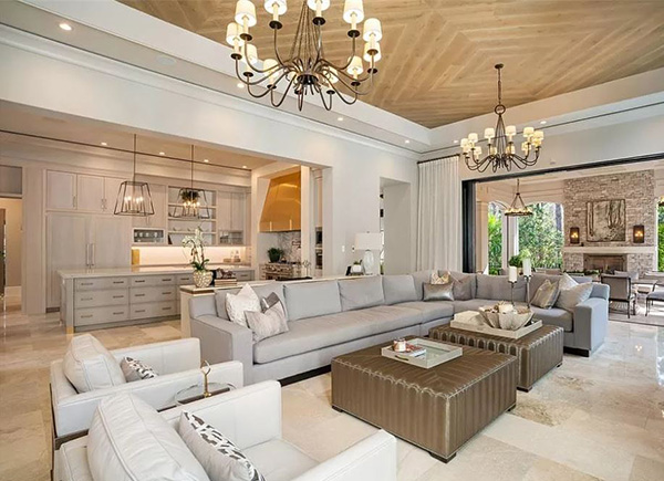 Family Room Open to Kitchen with Recessed and Chandelier Lighting